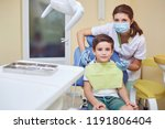a child with a dentist in a... | Shutterstock . vector #1191806404