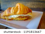 sausage egg and cheese on flaky ... | Shutterstock . vector #1191813667