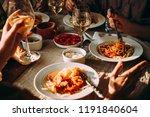 friends having a pasta dinner... | Shutterstock . vector #1191840604