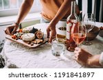 offering appetizers at a... | Shutterstock . vector #1191841897