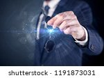 businessman in suit holding... | Shutterstock . vector #1191873031