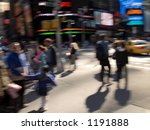 A abstract motion blur of a busy corner in Times Square in Manhattan. - stock photo