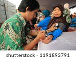 a health worker is examining... | Shutterstock . vector #1191893791