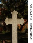 tombstone cross on a cemetery... | Shutterstock . vector #1191924127
