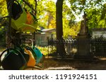 many watering cans on a cemetry ... | Shutterstock . vector #1191924151