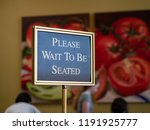 a please wait to be seated sign ... | Shutterstock . vector #1191925777