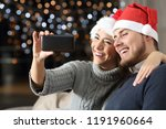 couple having a video call on... | Shutterstock . vector #1191960664