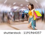 cheerful young woman holding... | Shutterstock . vector #1191964357