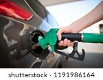 closeup of man pumping gasoline ... | Shutterstock . vector #1191986164