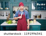 man chef wear apron cooking in... | Shutterstock . vector #1191996541