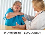senior adult woman talking with ... | Shutterstock . vector #1192000804