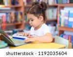 little child indoors in front... | Shutterstock . vector #1192035604
