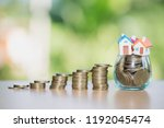 mini house on stack of coins ... | Shutterstock . vector #1192045474