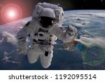 astronaut flying in outer space ... | Shutterstock . vector #1192095514