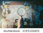 detective hand holding a... | Shutterstock . vector #1192132651