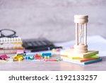 classic wooden hourglass or... | Shutterstock . vector #1192133257