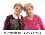 older women friends embrace and ...   Shutterstock . vector #1192157971