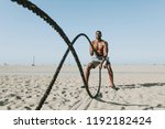 fit man working out with battle ...   Shutterstock . vector #1192182424