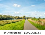 older man and woman cycle on a... | Shutterstock . vector #1192208167