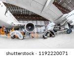 aircraft in the hangar repair... | Shutterstock . vector #1192220071
