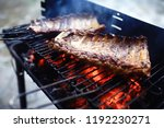 pork ribs on the grill cooking... | Shutterstock . vector #1192230271