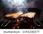 pork ribs on the grill cooking... | Shutterstock . vector #1192230277