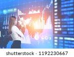 blonde businesswoman looking at ... | Shutterstock . vector #1192230667