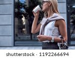 young stylish woman drinks her... | Shutterstock . vector #1192266694