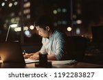 Young Asian Businessman Writing ...