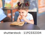 kid devours croissant. cute... | Shutterstock . vector #1192332334
