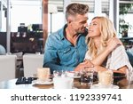 happy couple hugging and going... | Shutterstock . vector #1192339741