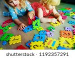 kids playing with puzzle ... | Shutterstock . vector #1192357291