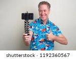 portrait of mature tourist man... | Shutterstock . vector #1192360567