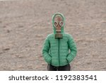 Child In A Gas Mask On A...