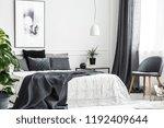 modern  gray chair with wooden... | Shutterstock . vector #1192409644
