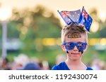 cute australian boy with flags... | Shutterstock . vector #1192430074