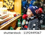 little kid boy eating sugar... | Shutterstock . vector #1192449367