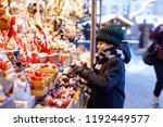 little cute kid boy selecting... | Shutterstock . vector #1192449577