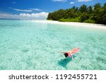 woman swim and relax in the sea.... | Shutterstock . vector #1192455721