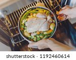 cook putting raw chicken with... | Shutterstock . vector #1192460614