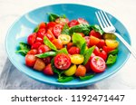 fresh bright tomato salad from... | Shutterstock . vector #1192471447