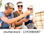 three friends on the beach... | Shutterstock . vector #1192480087