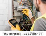 cropped image of electrician... | Shutterstock . vector #1192486474