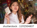 sad disappointed asian woman... | Shutterstock . vector #1192504837