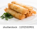 five cigar pastries on a white... | Shutterstock . vector #1192533901
