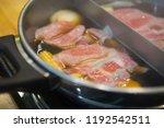 closeup of sliced pork in hot...   Shutterstock . vector #1192542511