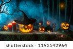 halloween pumpkins on dark... | Shutterstock . vector #1192542964