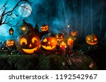 halloween pumpkins on dark... | Shutterstock . vector #1192542967
