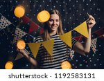 woman at home hanging christmas ...   Shutterstock . vector #1192583131
