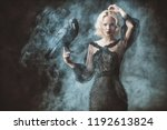 a beautiful blonde lady with a... | Shutterstock . vector #1192613824